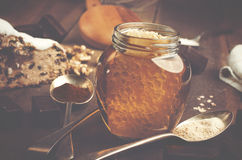 Jar of healthy real honey with honeycomb inside,  chocolate mars Royalty Free Stock Images
