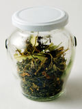 Jar of Herbal Tea. Close up of a clear, decorative jar of coarsely ground herbal tea Stock Photo