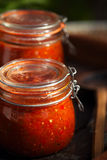 Jar of home made classic spicy Tomato salsa Royalty Free Stock Images