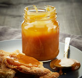 Jar of homemade caramel cream Royalty Free Stock Photos