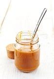 Jar of homemade caramel cream Royalty Free Stock Photo