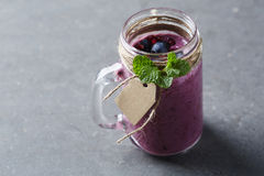Jar of homemade fruit smoothie,  studio Royalty Free Stock Photography