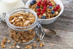 Jar with homemade granola, milk and fresh berries, top view. Horizontal Stock Photos