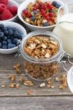 Jar with homemade granola, milk and fresh berries, vertical Stock Photo