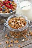 Jar with homemade granola, milk and fresh berries, vertical Stock Image