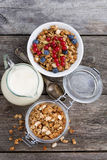 Jar with homemade granola, milk and fresh berries. On wooden table, top view vertical, closeup Royalty Free Stock Images