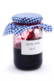 Jar of homemade jam over white. Jar of homemade jam on a white background Royalty Free Stock Images