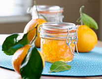 Jar of homemade orange jam. Closeup photo shot with selective focus of a jar of homemade orange jam Stock Images