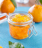 Jar of homemade orange preserves. Close up photo of a jar of homemade orange preserves with open lid Stock Photo