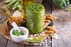 Jar with homemade pesto sauce Royalty Free Stock Image