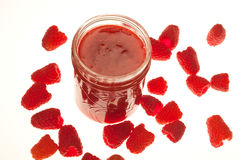 Jar of homemade raspberry jam with fresh berries Royalty Free Stock Photography