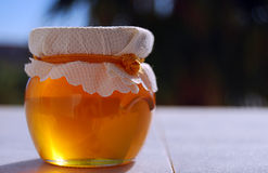 Jar of honey Stock Photos