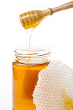 Jar of honey. With wooden and bee wax Stock Photo