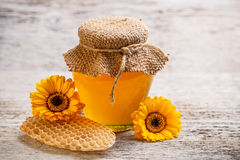 Jar of honey Royalty Free Stock Image