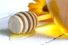 Jar of honey closeup on white planks Royalty Free Stock Image