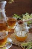 Jar of honey and cups with linden tea Stock Photos