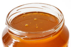 Jar of honey Royalty Free Stock Photography