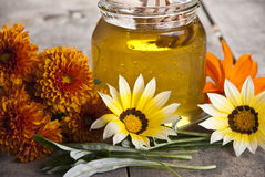 Jar of honey with different flowers. Close up Stock Photography