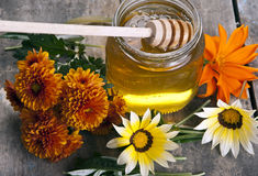 Jar of honey with different flowers. Close up Royalty Free Stock Photo