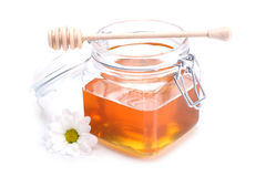 Jar of honey , dipper and flower. On white background Royalty Free Stock Image