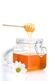 Jar of honey, dipper and toast Royalty Free Stock Photo