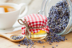 Jar of honey, dry healthy lavender tea and tea cup Royalty Free Stock Photography
