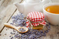 Jar of honey, dry lavender flowers, tea cup and teapot Royalty Free Stock Image