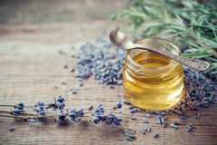 Jar of honey and dry  lavender flowers for tea. Stock Photos