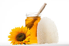 Jar of honey with flower. Jar of honey with wooden isolated Stock Image