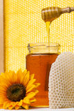 Jar of honey with flower and the yellow background. Jar of honey with wooden and yellow background. Flower on the floor Stock Photography