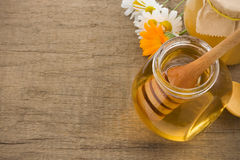 Jar of honey and flowers Stock Images