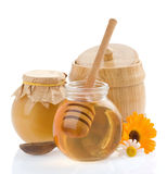 Jar of honey and flowers Stock Photography
