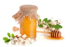 Jar of honey with flowers of acacia isolated on white background Stock Photography