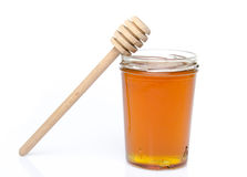 Jar of honey with a honey dipper Royalty Free Stock Photography
