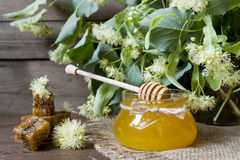 Jar with honey, honeycomb with pollen and linden flowers Royalty Free Stock Photography