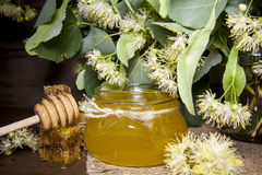 Jar with honey, honeycomb with pollen and linden flowers Stock Photography