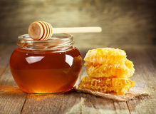 Jar of honey with honeycomb Royalty Free Stock Photo