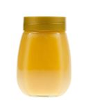 A jar of honey isolated Royalty Free Stock Photography