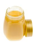 A jar of honey isolated. On a white background Stock Photos