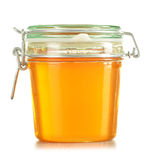 Jar of honey isolated on white Royalty Free Stock Images
