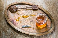 Jar of honey. Jars of honey,vintage spoon Royalty Free Stock Image