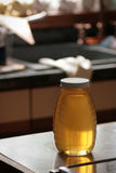 Jar of Honey on Kitchen Counter Royalty Free Stock Photos