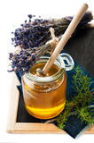 Jar of honey with lavender flowers Royalty Free Stock Photos