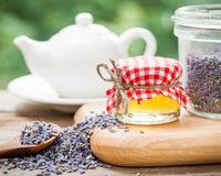 Jar of honey, lavender tea and teapot on background. Royalty Free Stock Image