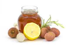 Jar of honey, lemon and lychees Stock Images