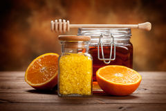 Jar of honey and orange bath salt Stock Images