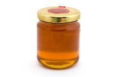 Jar of Honey over white Royalty Free Stock Photography