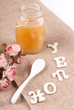Jar with honey and spoon Royalty Free Stock Photos
