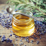 Jar of honey, spoon and dry lavender flowers. Stock Images