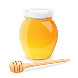 A jar of honey and spoon for honey. Stock Photography